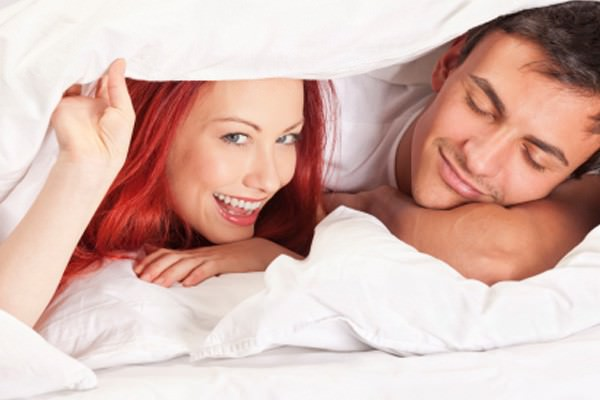 Cheerful young couple in bed. Christian Sex 300x199.
